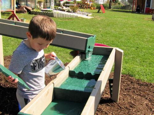 Control the flow of water through channels in our new water table.