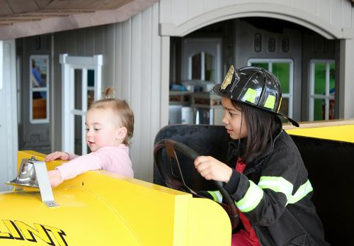 Dress up as firemen and drive the fire truck in Our Town exhibit .